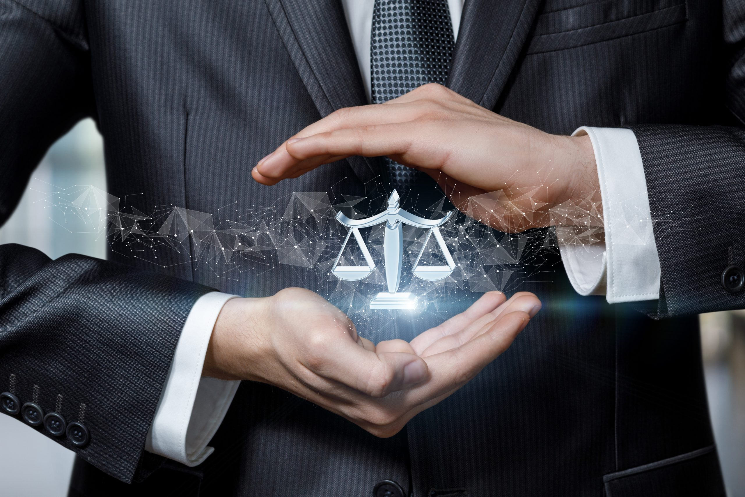 Justice protection concept. Hands protect by gesture the scales of justice icon.